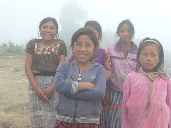 Young women in the mountain fog